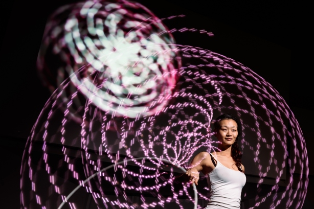 A performer from Starlight Alchemy demonstrates LiveLight, an interactive installation artwork by Quck Zhong Yi that will be showcased at i Light Marina Bay 2014. Photo courtesy of Max Pagel.
